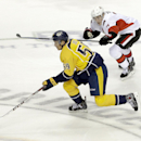 Nashville Predators defenseman Roman Josi (59), of Switzerland, moves the puck ahead of Ottawa Senators center Kyle Turris (7) in the second period of an NHL hockey game Thursday, Oct. 9, 2014, in Nashville, Tenn The Associated Press