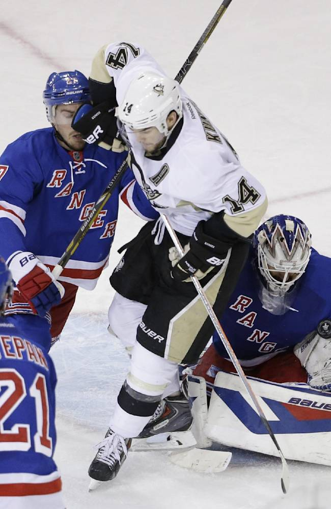 New York Rangers goalie Henrik Lundqvist (30) of Sweden, right, blocks a shot while New York Rangers defenseman Ryan McDonagh (27), second from left, and Pittsburgh Penguins left wing Chris Kunitz (14) collide during the second period of Game 6 of a second-round NHL playoff hockey series, Sunday, May 11, 2014, in New York