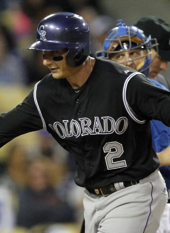 Rockies score 3 in 11th, hold off Dodgers 5-4
