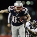FILE - In this Jan. 20, 2013, file photo, New England Patriots wide receiver Wes Welker (83) runs out of the tackle of Baltimore Ravens free safety Ed Reed (20) during the first half of the AFC championship NFL football game in Foxborough, Mass.  All 32 teams are under the $123 million salary cap, but how much teams want to wheel and deal is unclear. Those available include Ed Reed and Dashon Goldson and Welker. (AP Photo/Matt Slocum, File)