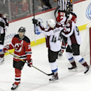 Colorado Avalanche center Matt Duchene, left, celebrates with teammates Ryan Wilson (44) and Ryan O'Reilly (90) after scoring a goal on the New Jersey Devils during the third period of an NHL hockey game, Saturday, Nov. 15, 2014, in Newark, N.J. Devils' l