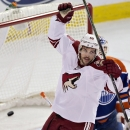 Arizona Coyotes Antoine Vermette (50) celebrates a goal by a teammate against Edmonton Oilers goalie Ben Scrivens (30) during first period NHL hockey action in Edmonton, Alberta, on Sunday, Nov. 16, 2014 The Associated Press