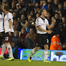 Fulham s Scott Parker, right, celebrates with teammates after scoring against Swansea City, during their English Premier League soccer match, at the Craven Cottage stadium in London, Saturday, Nov. 23, 2013