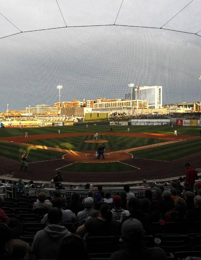 A crowd watches a spring exhibition baseball game between the Chicago White Sox and the Birmingham Barons on Friday, March 28, 2014, in Birmingham, Ala