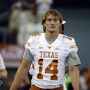 Texas quarterback David Ash stands on the sidelines as the team warms up before an NCAA college football game against UCLA, Saturday, Sept. 13, 2014, in Arlington, Texas. (AP Photo/Tony Gutierrez)