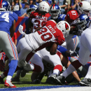 Arizona Cardinals running back Jonathan Dwyer (20) rushes for a touchdown during the first half of an NFL football game against the New York Giants, Sunday, Sept. 14, 2014, in East Rutherford, N.J The Associated Press