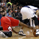 Chicago Bulls guard Jimmy Butler, left, reaches under Dallas Mavericks guard Monta Ellis to take away the ball during the first half of an NBA basketball game on Friday, Feb. 28, 2014, in Dallas The Associated Press