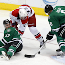 Dallas Stars defensemen Alex Goligoski (33) and Trevor Daley (6) keep Carolina Hurricanes center Eric Staal (12) away from the goal during the third period of an NHL hockey game on Thursday, Feb. 27, 2014, in Dallas The Associated Press