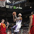 SACRAMENTO, CA - JANUARY 12: DeMarcus Cousins #15 of the Sacramento Kings takes the ball to the basket against the Cleveland Cavaliers at Sleep Train Arena on January 12, 2014 in Sacramento, California. (Photo by Rocky Widner/NBAE via Getty Images)