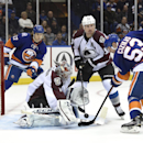 Colorado Avalanche goalie Semyon Varlamov (1) blocks a shot on goal by New York Islanders center Casey Cizikas (53) as Islanders left wing Matt Martin (17) and Avalanche's left wing Cody McLeod (55) look on in the second period of an NHL hockey game at N