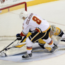 Calgary Flames center Joe Colborne (8) scores a goal against Nashville Predators goalie Pekka Rinne (35) during a shootout at an NHL hockey game Tuesday, Oct. 14, 2014, in Nashville, Tenn. The Calgary Flames won 3-2 The Associated Press