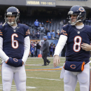 Chicago Bears quarterbacks Jay Cutler (6) and Jimmy Clausen (8) warm up before an NFL football game against the Detroit Lions Sunday, Dec. 21, 2014, in Chicago. (AP Photo/Nam Y. Huh)