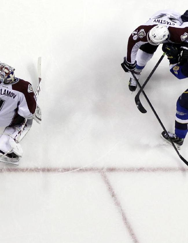 A shot by St. Louis Blues' Vladimir Tarasenko (91), of Russia, slips past Colorado Avalanche goalie Semyon Varlamov, left, also of Russia, as the Avalanche's Paul Stastny (26) watches during the second period of an NHL hockey game Thursday, Nov. 14, 2013, in St. Louis