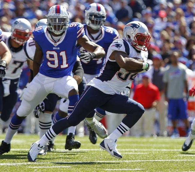 New England Patriots Shane Vereen (34) runs against Buffalo Bills Manny Lawson (91) during the first half of an NFL football game Sunday, Sept. 8, 2013, in Orchard Park
