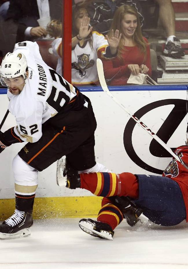 After knocking Florida Panthers' Mike Weaver (43) to the ice, Anaheim Ducks' Patrick Maroon (62) chases the puck during the first period of an NHL hockey game in Sunrise, Fla., Tuesday, Nov. 12, 2013
