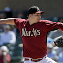 Arizona Diamondbacks starting pitcher Trevor Cahill throw to a Cleveland Indians during the first inning of an exhibition baseball game in Scottsdale, Ariz., Tuesday, March 11, 2014 The Associated Press