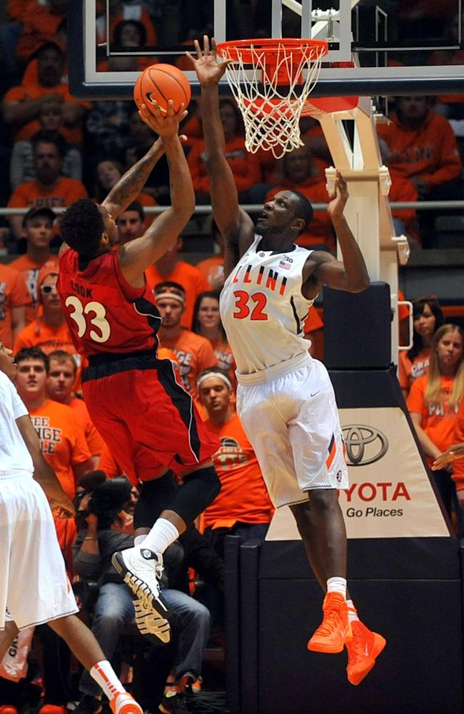 Illinois forward/center Nnanna Egwu (32) challenges a shot attempt by Jacksonville State forward Nick Cook (33) in the second half of an NCAA college basketball game Sunday, Nov. 10, 2013, in Champaign, Ill