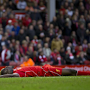 Liverpool's Mario Balotelli reacts after a missed opportunity during his team's 0-0 draw against Hull, during their English Premier League soccer match at Anfield Stadium, Liverpool, England, Saturday Oct. 25, 2014