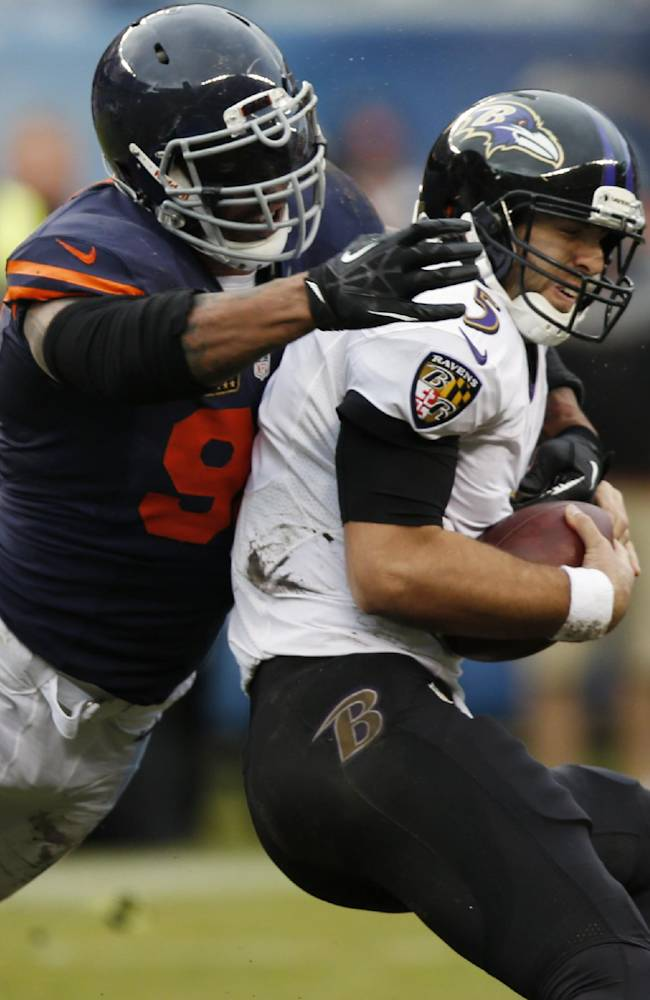 Chicago Bears defensive end Julius Peppers (90) sacks Baltimore Ravens quarterback Joe Flacco (5) during the first half of an NFL football game, Sunday, Nov. 17, 2013, in Chicago