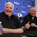 St. Louis Blues head coach Ken Hitchcock smiles along side general manager Doug Armstrong, right, during a news conference Tuesday, May 26, 2015, in St. Louis. The Blues are sticking with Hitchcock for another season, announcing the veteran NHL hockey coach has signed a one-year contract with the team. (AP Photo/Jeff Roberson)