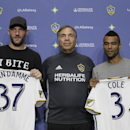 LA Galaxy head coach and general manager, Bruce Arena, center, introduces Jelle Van Damme, left, from Standard Liege in Belgium, and former Arsenal and Chelsea defender Ashley Cole at the StubHub Center in Carson, Calif., on Friday, Feb. 5, 2016. With th