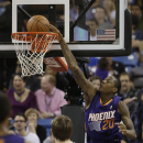 Phoenix Suns guard Archie Goodwin, right, stuffs over Sacramento Kings center Aaron Gray during the fourth quarter of an NBA basketball game in Sacramento, Calif., Wednesday, April 16, 2014. The Suns won 104-99 The Associated Press