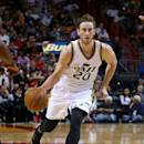 MIAMI, FL - DECEMBER 17: Gordon Hayward #20 of the Utah Jazz drives to the lane during a game against the Miami Heat at American Airlines Arena on December 17, 2014 in Miami, Florida. (Photo by Mike Ehrmann/Getty Images)