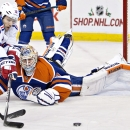 New York Rangers' Lee Stempniak (12) is stopped by Edmonton Oilers goalie Ben Scrivens (30) during first period NHL hockey action in Edmonton, Alberta, on Sunday, Dec. 14, 2014 The Associated Press