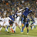 San Jose Earthquakes midfielder Atiba Harris (23) attempts a header on goal against Real Salt Lake midfielder Ned Grabavoy during the second half of an MLS soccer match Saturday, Aug. 30, 2014, in Santa Clara, Calif. The game ended in a 1-1 tie The Associ