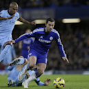 Chelsea's Eden Hazard, right, breaks away from Manchester City's Fernandinho, left, during the English Premier League soccer match between Chelsea and Manchester City at Stamford Bridge, London, Saturday, Jan. 31, 2015