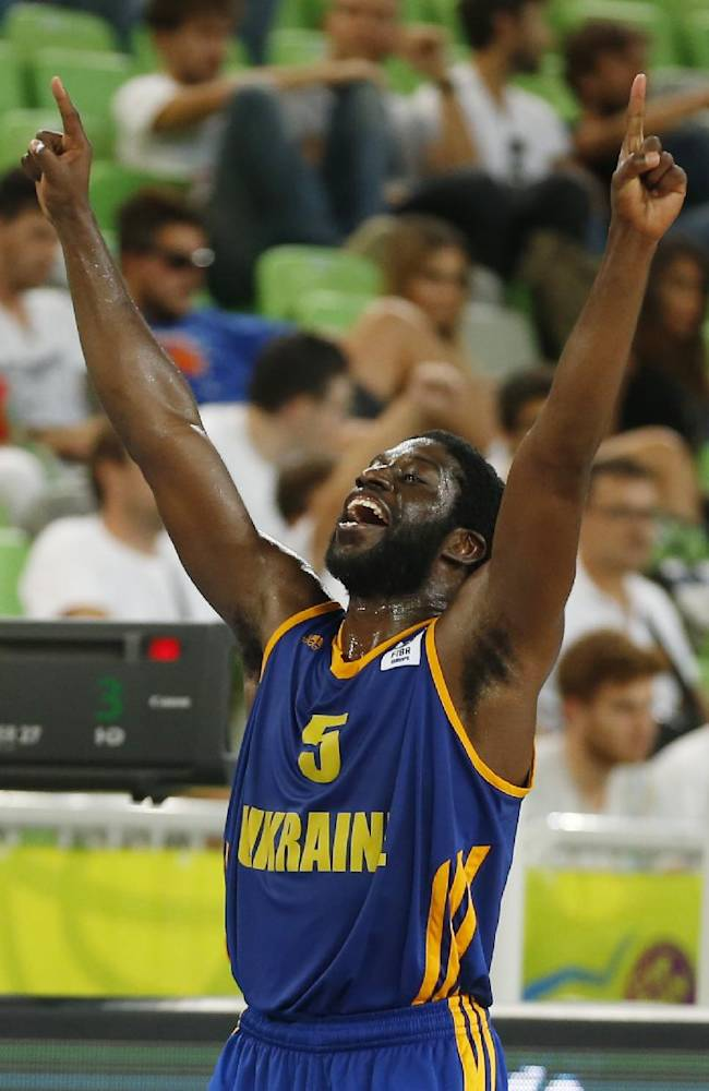 Ukraine's Eugene Jeter celebrates after the EuroBasket European Basketball Championship classification 5th to 8th place play off match Against Italy in Ljubljana, Slovenia, Friday, Sept. 20, 2013. Ukraine won the match 66-58