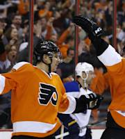 Philadelphia Flyers' Brayden Schenn, left, and Vincent Lecavalier celebrate after Schenn's goal during the second period of an NHL hockey game against the St. Louis Blues, Saturday, March 22, 2014, in Philadelphia. Philadelphia won 4-1. (AP Photo/Matt Slocum)