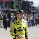 Sprint Cup Series driver Matt Kenseth walks to his car before practice at Texas Motor Speedway in Fort Worth, Texas, Friday, Oct. 31, 2014. (AP Photo/LM Otero)
