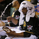 Pittsburgh Pirates starting pitcher Edinson Volquez cleans his spikes in the sixth inning of a baseball game against the Cincinnati Reds in Pittsburgh Tuesday, April 22, 2014 The Associated Press