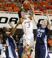 Oklahoma State's Tiffany Bias (3) goes to the basket between San Diego's Dominique Conners, left, and Klara Wischer (21) during a women's NIT college basketball tournament semifinal in Stillwater, Okla., Wednesday, March 28, 2012. (AP Photo/The Oklahoman, Bryan Terry)