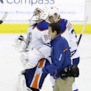 A trainer helps Edmonton Oilers goalie Ilya Bryzgalov (80) off the ice after he was hit hard during the first period of an NHL hockey game against the Dallas Stars, Sunday, Dec. 1, 2013, in Dallas. The Oilers won 3-2 The Associated Press