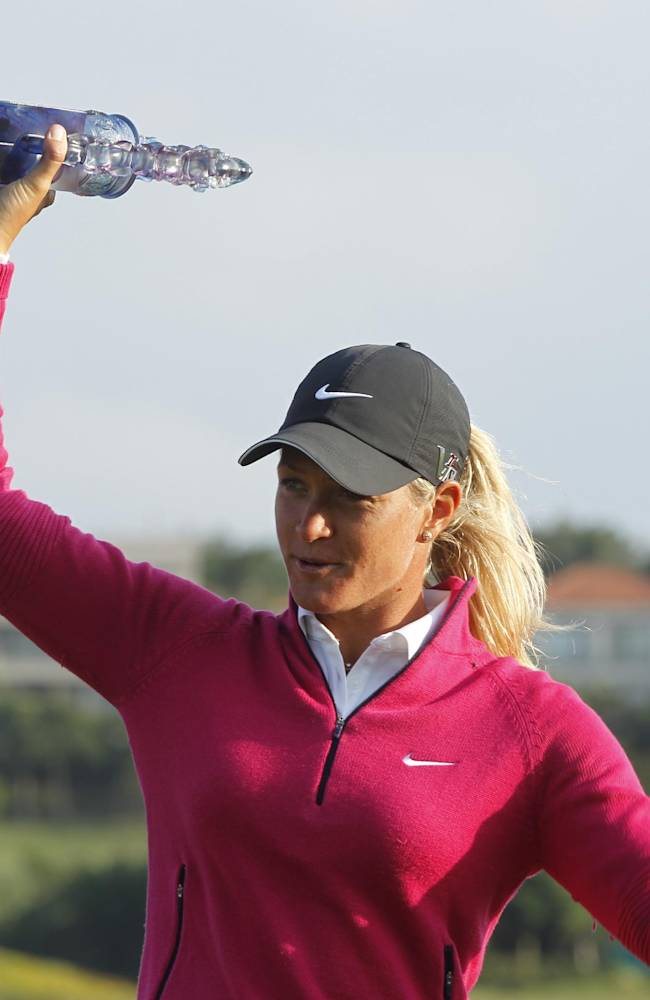 Suzann Pettersen of Norway, holds her trophy for media after winning the LPGA Taiwan Championship tournament at the Sunrise Golf & Country Club, Sunday, Oct. 27, 2013, in Yangmei, northern Taiwan. Pettersen finished the tournament with 9 under par with total of 279