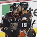 FILE - In this May 16, 2014 file photo, Anaheim Ducks right wing Teemu Selanne, of Finland, left, gets a hug from center Ryan Getzlaf after they were defeated by the Los Angeles Kings in Game 7 of an NHL hockey second-round Stanley Cup playoff series in Anaheim, Calif. Selanne managed to make a stir on the first day of the Anaheim Ducks' training camp even after his retirement. Coach Bruce Boudreau and Selanne's former teammates  reacted with disappointment and chuckles Thursday, Sept. 18, 2014, after hearing about Selanne's fierce criticism of Boudreau in a new biography published in Finland.  (AP Photo/Mark J. Terrill, File)