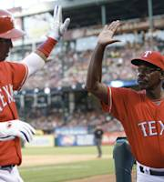 Texas Rangers manager Ron Washington, right, congratulates player Leonys Martin after his run against the Los Angeles Angels during the sixth inning of a baseball game, Monday, July 29, 2013, in Arlington, Texas. (AP Photo/Jim Cowsert)