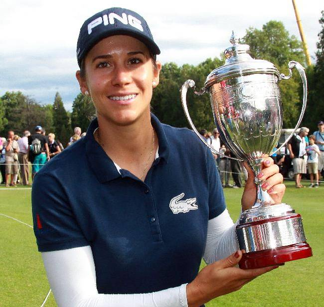 Azahara Munoz of Spain holds her trophy at the women's Open in Saint Jean de Luz, southwestern France, Sunday, Sept. 29, 2013