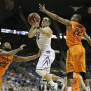Kansas State guard Angel Rodriguez (13) puts up a shot between Oklahoma State forward Michael Cobbins (20) and guard Markel Brown (22) during the second half of an NCAA college basketball game in the Big 12 men's tournament Friday, March 15, 2013, in Kansas City, Mo. Kansas State won the game 68-57. (AP Photo/Charlie Riedel)