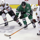 Dallas Stars right wing Alex Chiasson (12) skates for the puck against Chicago Blackhawks center Michal Handzus (26) and defenseman Johnny Oduya (27) during the first period of an NHL hockey game Friday, Nov. 29, 2013, in Dallas The Associated Press
