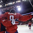Washington Capitals left wing Alex Ovechkin (8), from Russia, celebrates with defenseman John Carlson (74) after scoring a goal in the first period of an NHL hockey game against the New Jersey Devils, Thursday, Oct. 16, 2014, in Washington The Associated