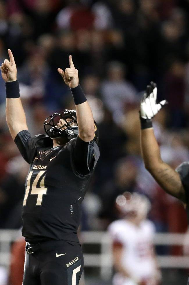 Baylor quarterback Bryce Petty (14) and running back Shock Linwood (32) celebrate a touchdown catch by Antwan Goodley in the second half of an NCAA college football game against Oklahoma, Thursday, Nov. 7, 2013, in Waco, Texas. Baylor won 41-12
