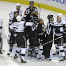 Linesman Michel Cormier (76) separates Los Angeles Kings' Matt Greene, third from right, from San Jose Sharks' Raffi Torres (13) during the third period of Game 2 of an NHL hockey first-round playoff series Sunday, April 20, 2014, in San Jose, Calif The A