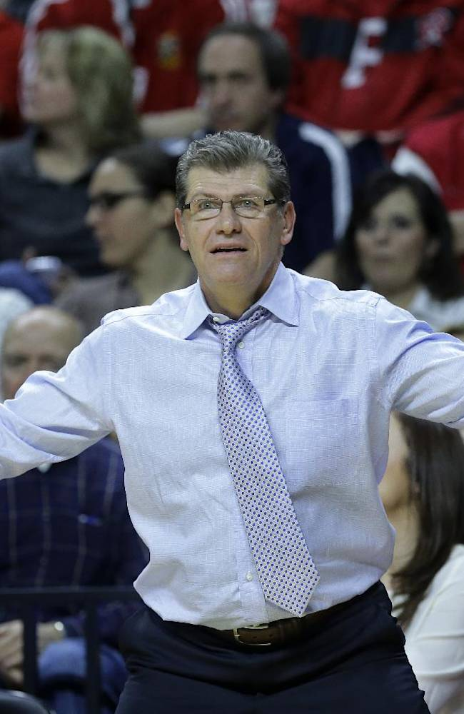 Connecticut head coach Geno Auriemma reacts to play during the first half of an NCAA college basketball game against Rutgers, Sunday, Jan. 19, 2014, in Piscataway, N.J. Connecticut won 94-64