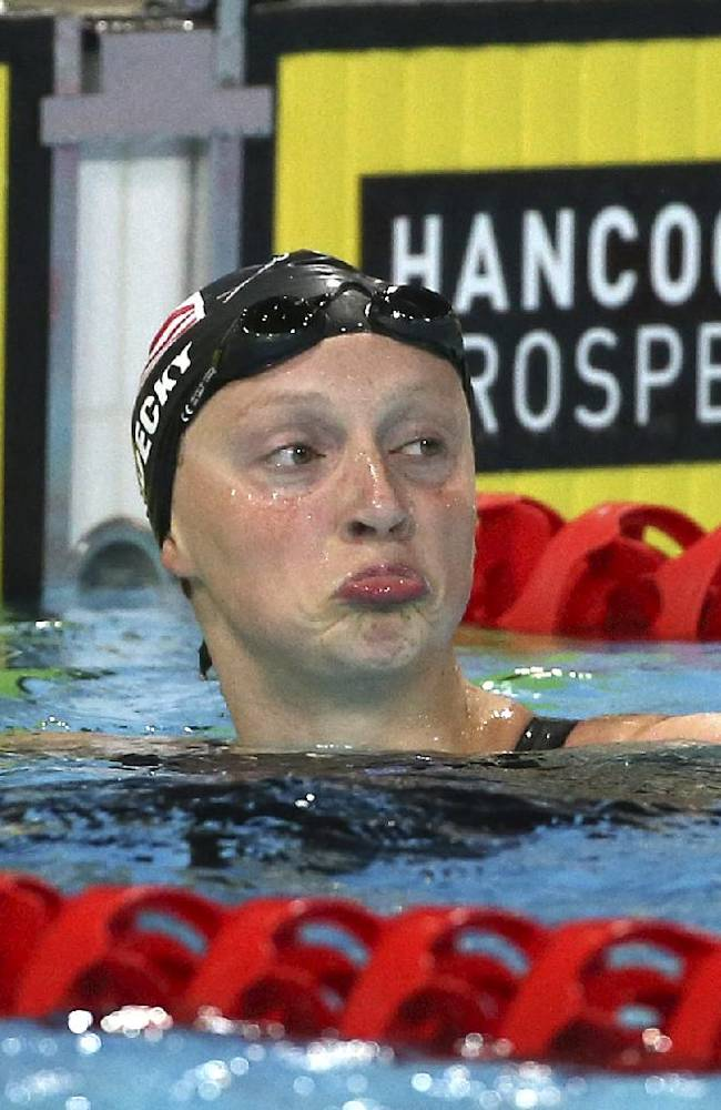 Katie Ledecky of the U.S. pulls a funny face after her women's 800m freestyle final at the Pan Pacific swimming championships in Gold Coast, Australia, Thursday, Aug. 21, 2014