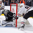 Chicago Blackhawks right wing Marian Hossa, right, of Slovakia, tries to get a shot in on Los Angeles Kings goalie Jonathan Quick during the third period of an NHL hockey game, Wednesday, Jan. 28, 2015, in Los Angeles. The Kings won 4-3 The Associated Pr