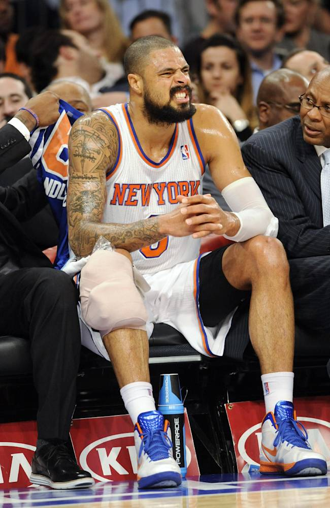 New York Knicks' Tyson Chandler sits on the bench with his knee wrapped after being injured during the first quarter of an NBA basketball game against the Charlotte Bobcats on Tuesday, Nov. 5, 2013, at Madison Square Garden in New York