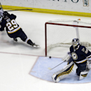 Dallas Stars' Colton Sceviour, top left, watches as his shot slowly slips past St. Louis Blues goalie Ryan Miller, right, for a goal as Blues' Steve Ott (29) defends during the second period of an NHL hockey game Saturday, March 29, 2014, in St. Louis The